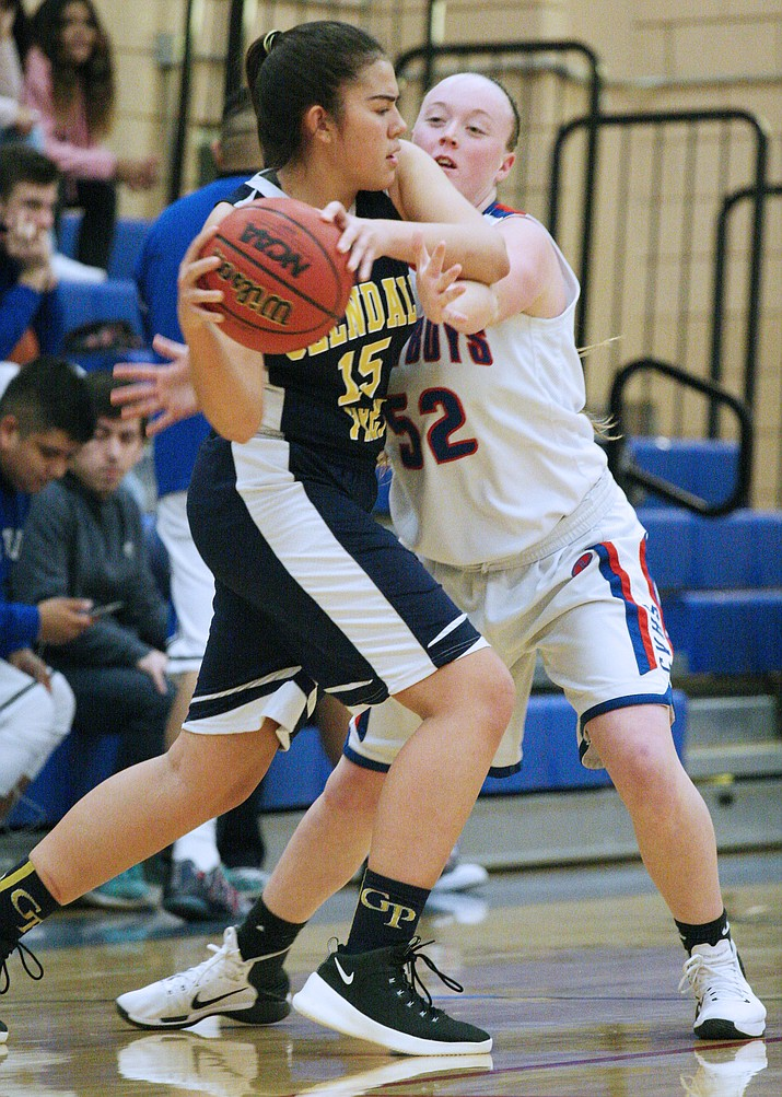 Camp Verde's Destiny Dowdle guards a defender in the Cowboys' 40-31 loss at home to Glendale Prep on Tuesday.
