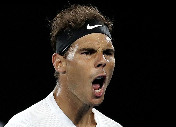 Spain's Rafael Nadal yells while playing Canada's Milos Raonic during their quarterfinal at the Australian Open tennis championships in Melbourne, Australia, Wednesday, Jan. 25, 2017.