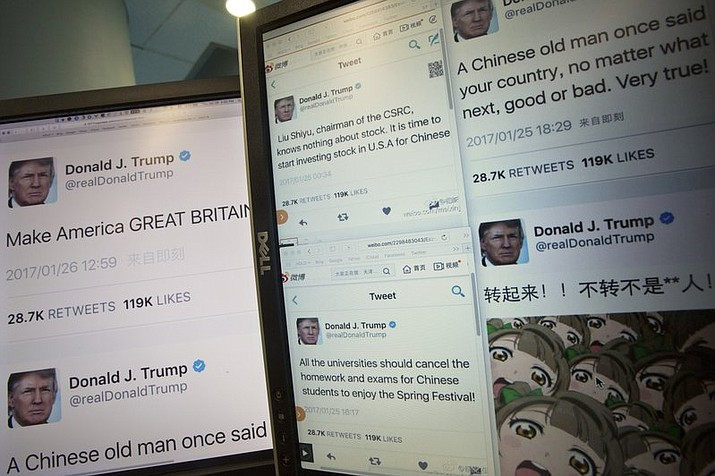 Computer screens display fake tweets that online users can self-generate on a Chinese website in Beijing, China, Jan. 26, 2017.