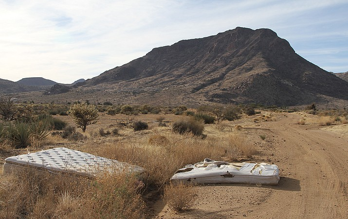 Mattresses and other trash litter the desert landscape north of town north and west of Mohave Community College.