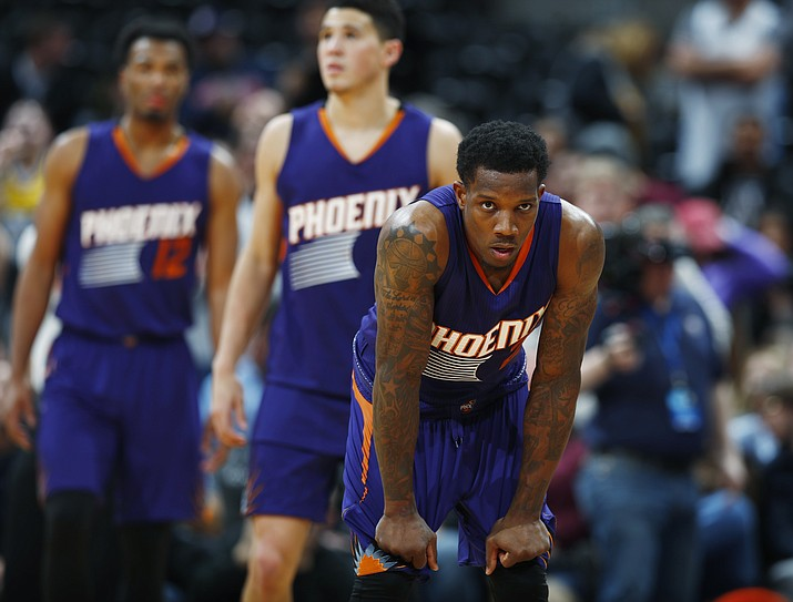 Phoenix Suns guards Eric Bledsoe, front, and Devin Booker, center, and forward TJ Warren (12) react as time runs out in the second half of an NBA basketball game against the Denver Nuggets on Thursday, Jan. 26, in Denver. The Nuggets won 127-120. (David Zalubowski/Associated Press)