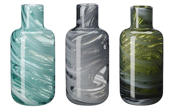 This undated photo provided by Ikea shows marbled vases made of glass scraps and rejected pieces from one of Ikea's suppliers. The vases are created by Iina Vuorivirta, and they're part of Ikea's PS 2017 accessories line. Designers and manufacturers are finding creative ways to recycle waste products and castoffs. (Inter IKEA Systems B.V. via AP)