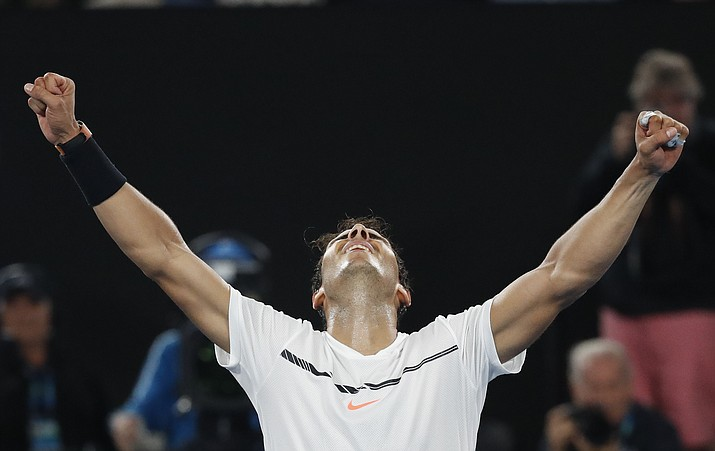 Spain's Rafael Nadal celebrates after defeating Bulgaria's Grigor Dimitrov during their semifinal at the Australian Open tennis championships in Melbourne, Australia, on Saturday, Jan. 28. (Kin Cheung/Associated Press)