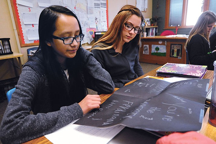 Twyla Begay and Isabella Cutaia read thank you notes from Sudanese student refugees in Christina Jones 7th grade social studies class at Prescott Mile High Middle School Friday, January 27.