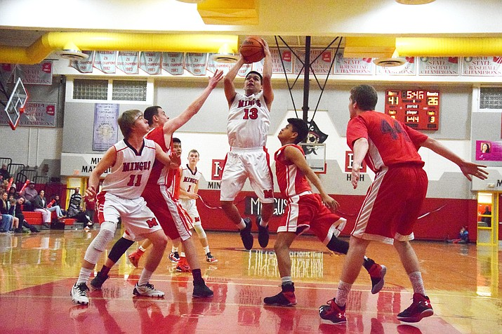 Mingus senior captain Issac Escalante weaves his way to the basket for 2 of his team-leading  22 points in the Marauders' one-sided 75-55 win over Coconino Friday. VVN/James Kelley