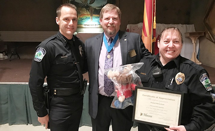 From left, Cottonwood Police Chief Steve Gesell, Moose International Heart of the Community Committee Member Allen Marx, Cottonwood Police Sergeant Monica Kuhlt.