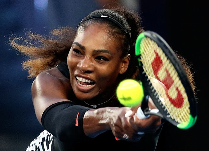 United States' Serena Williams makes a backhand return to her sister Venus during the women's singles final at the Australian Open tennis championships in Melbourne, Australia, Saturday, Jan. 28.