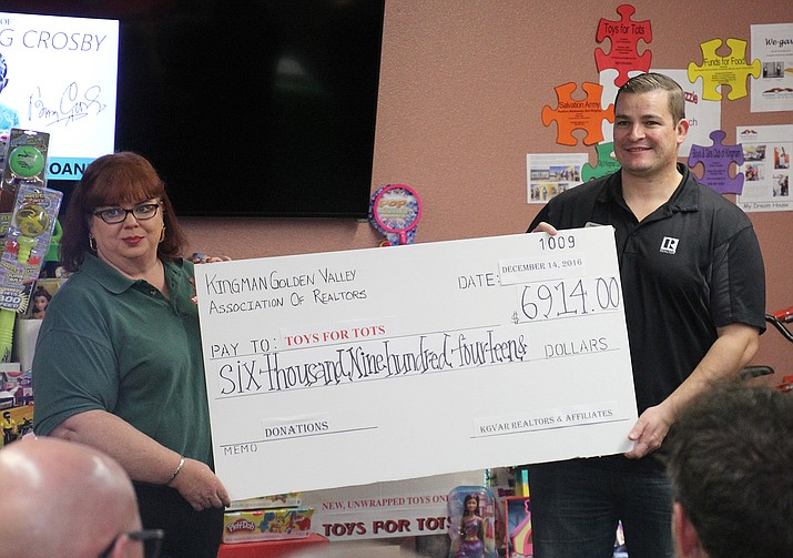 A check was presented to Toys for Tots by the Kingman Golden Valley Association of Realtors.