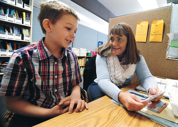 Volunteer Lori Decker works with Levi Fugitt as part of a specialized reading program at Taylor Hicks Elementary School in Prescott Thursday, Jan. 26.