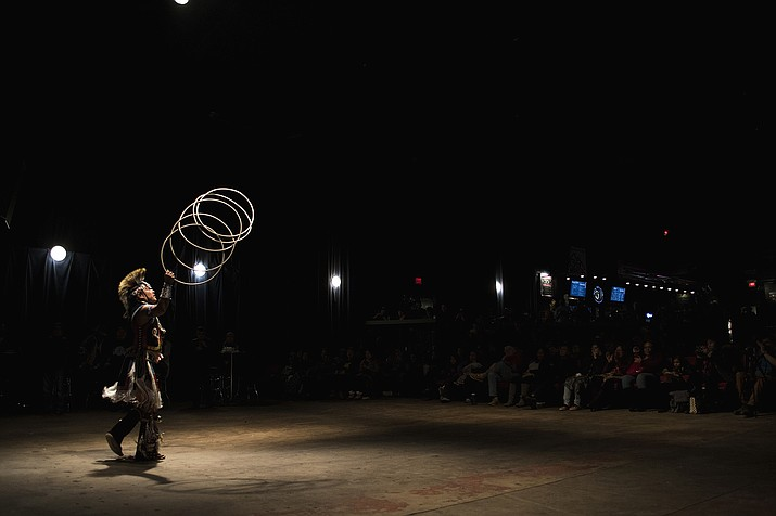 Derrick Suwaima Davis, seven time world champion hoop dance champion, performs at Rumble on the Mountain 3 in Flagstaff, Arizona at the Orpheum Theater to raise awareness of the plight of indigenous tribes from the Colorado Plateau Jan. 28. Photo/Robert Franklin