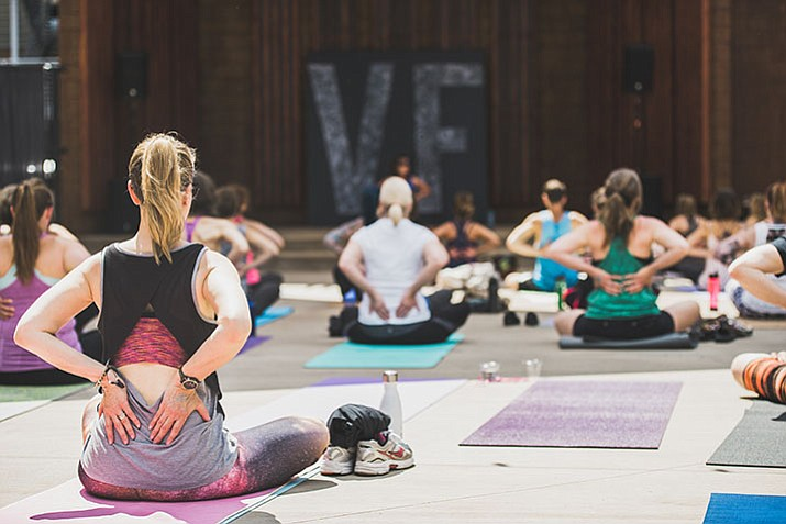 A yoga event hosted by VINYASA FIT – Hot Yoga Studio and BEND – Hot Yoga Prescott in downtown Prescott's Holiday Courtyard in May 2016.