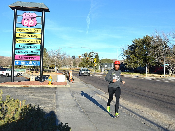 Rob Pope, England's version of Forrest Gump, runs through downtown Kingman.