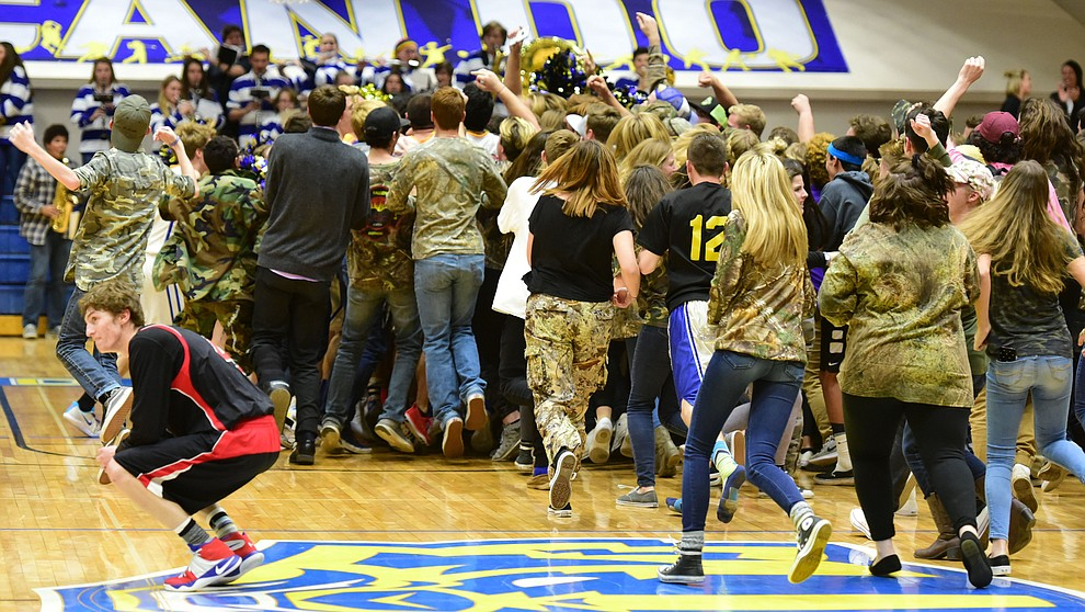 Prescott fans storm the court as the Badgers beat the Bradshaw Mountain Bears on a last second shot by Kody Jones Tuesday, January 31 in Prescott. (Les Stukenberg/The Daily Courier)