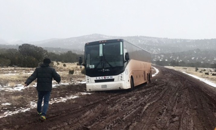 A tour bus carrying 44 tourists became stuck in the mud near Valle just prior to a Jan. 23 snowstorm.