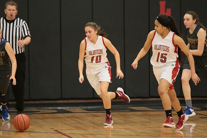 Lee Williams Madi Arave and Siava Allen chase a loose ball against Prescott at LWHS Friday night.