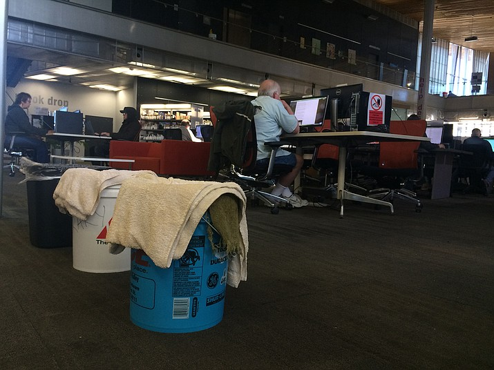 After a series of storms last week, the Prescott Valley Public Library had to put out buckets to catch the water leaking from the roof. The town filed a lawsuit this week to try to get the leaks repaired.