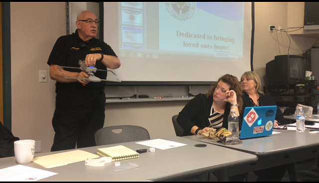 Prescott Valley Police Department Community Service Officer Jerry Ferguson demonstrates the Project Lifesaver locating device at the meeting on Thursday, Jan. 26.