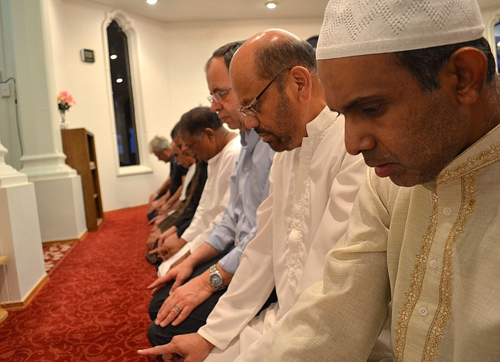 Local Muslims pray at the Masjid-E-Ibrahim Mosque celebrating the end of Ramadan in July.