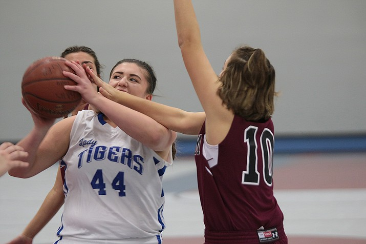 Kingman Academy's Amberlee Steed goes up for a shot against Trivium Prep.