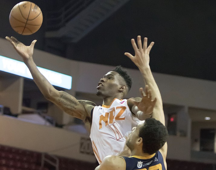 Northern Arizona's Derek Cooke Jr. (11) goes hard to the rim for a bucket against the Salt Lake City Stars on Wednesday, Feb. 1, at the Prescott Valley Event Center. Cooke collected a double-double with 10 points and 12 rebounds in a 115-92 loss to the Stars. (Matt Hinshaw/NAZ Suns)