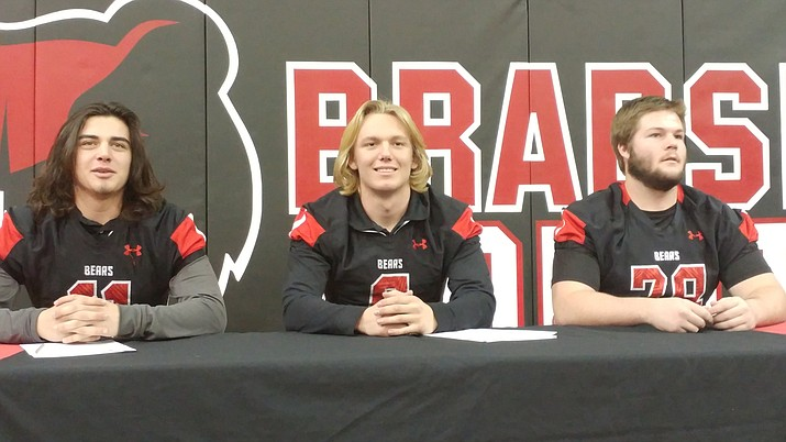 Bradshaw Mountain High football seniors, from left, Jake Morales, Gunner Bundrick and Kobey Rushton signed college letters of intent on National Signing Day Wednesday, Feb. 1, at Gary Kunow Gym in Prescott Valley.