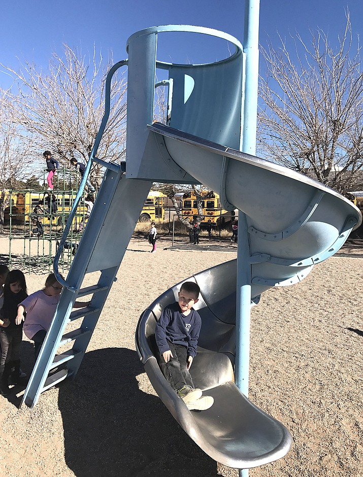 A Manzanita Elementary School kindergartner Carson Ungaro enjoys the slide during a recess break Wednesday afternoon.