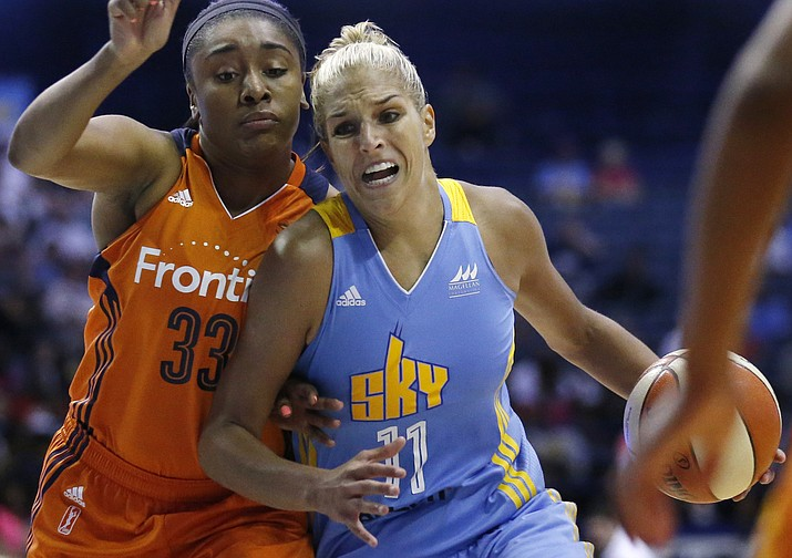 Chicago Sky forward Elena Delle Donne, right, drives as Connecticut Sun forward Morgan Tuck guards during the second half July 22, 2016, in Rosemont, Ill. The Sun won 94-89. (Nam Y. Huh/Associated Press, File)