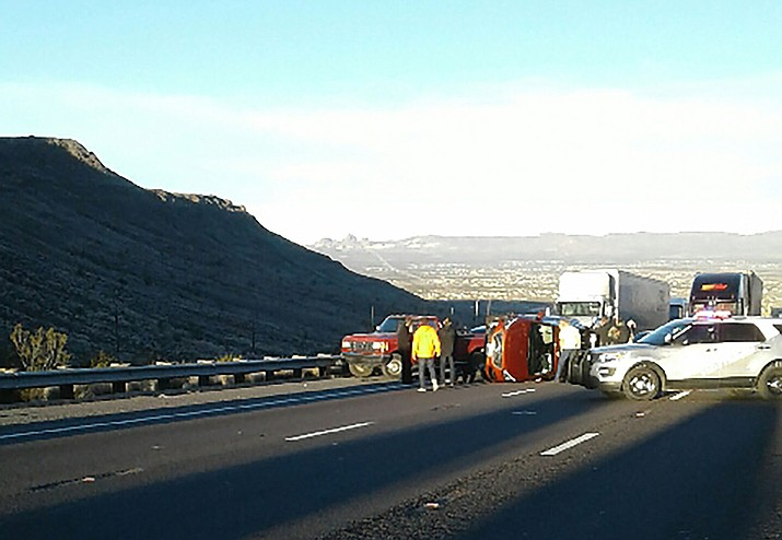 Photographer Marcia Gomez pulled off the road after sun glare temporary blinded her Wednesday morning while driving up Coyote Hill on U.S. Highway 93. She witnessed this accident, one of nine involving 26 cars in a chain reaction pileup, according to the Department of Public Safety.