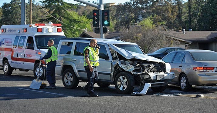 Personnel work a three-vehicle collision in April 2015 on Willow Creek Road in Prescott. Legislation could increase legal minimums for car insurance.