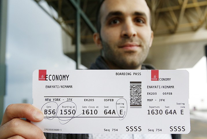 Just hours after an appeals court blocked an attempt to re-impose the travel ban, Iranian researcher Nima Enayati checked in on an Emirates Airline flight direct from Milan's Malpensa airport to New York's JFK Sunday.