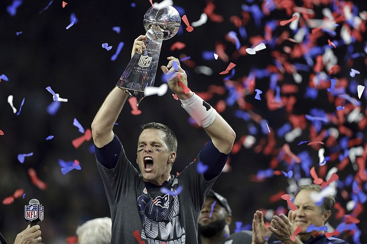 New England Patriots' Tom Brady raises the Vince Lombardi Trophy after defeating the Atlanta Falcons in overtime at the NFL Super Bowl 51 football game Sunday, Feb. 5, 2017, in Houston. The Patriots defeated the Falcons 34-28.