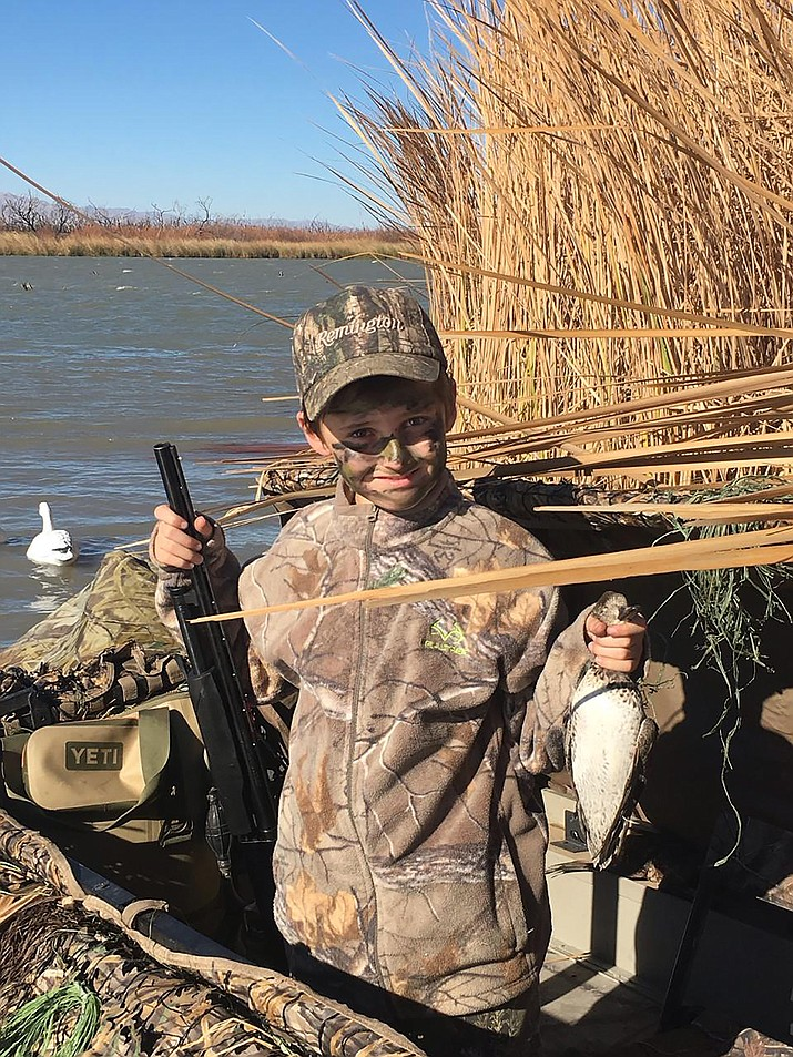 Ten-year-old Hunter Robison shows his first duck, a hen greenwing teal, that he bagged while hunting with his father at the Topock Marsh. The youngster has taken a lion, deer, and elk.