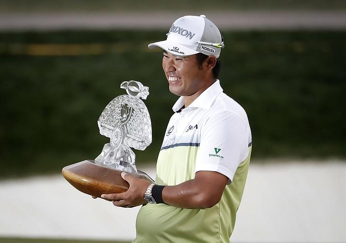 Hideki Matsuyama holds the champion's trophy after the Waste Management Phoenix Open golf tournament, Sunday, Feb. 5, in Scottsdale, Ariz.