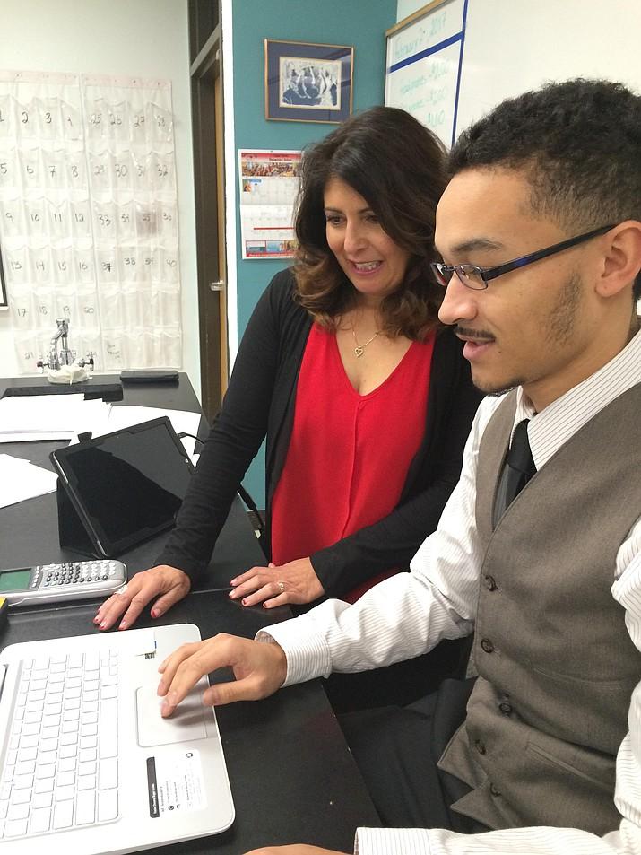 Prescott High School first-year chemistry teacher Todd Harris Jr. talks with instructional coach Alvina Green.