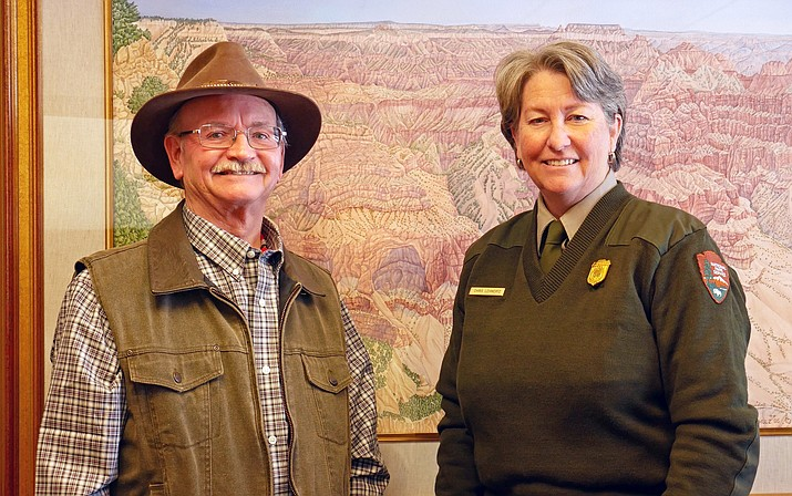 Superintendent Chris Lehnerta congratualtes Grand Canyon's 2017 annual pass photo contest winner Darrell Merideth.