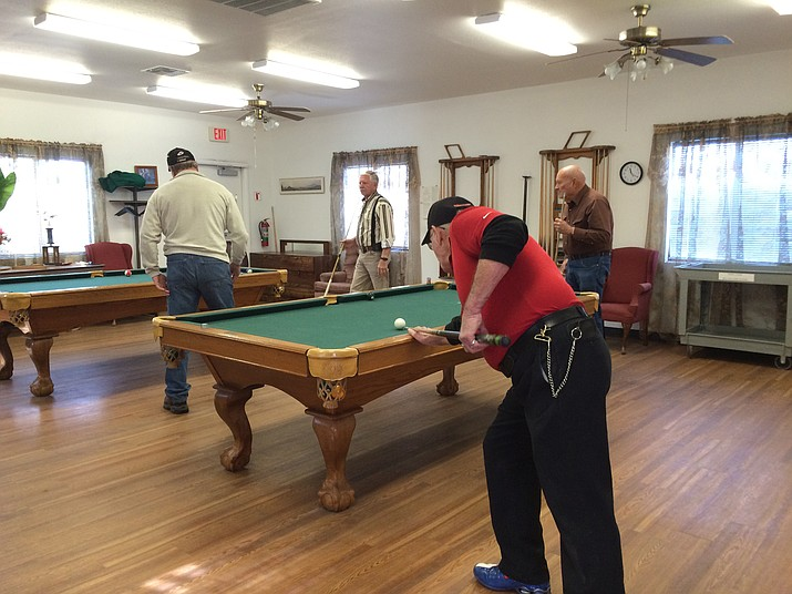 Men play pool at the Williams Senior Center.