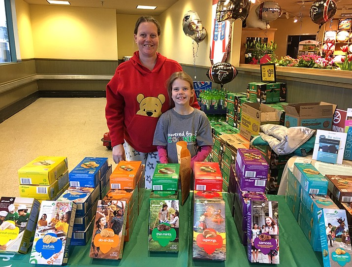 Kammy and Kendra Edens of Williams Brownie Troop 2616 sell Girl Scout cookies at Safeway Feb. 2.