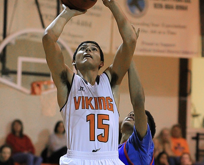 Viking Zack Perkins puts up a shot over a Mayer player Jan. 21.
