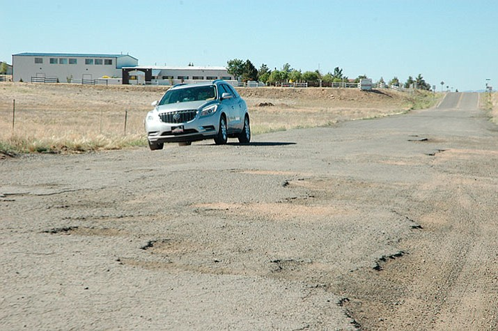 Viewpoint Drive in Prescott Valley was recently repaired after months of complaints about its poor condition. State lawmakers are considering adding a dime to the gasoline tax per gallon to improve roads around the state.