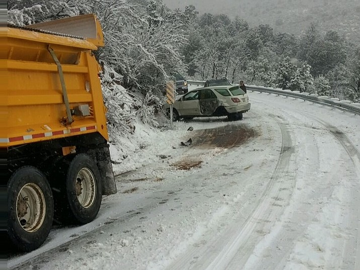 An SUV suffered serious damage Jan. 19 when it hit a snowplow clearing SR 89A between Prescott Valley and Jerome. (Arizona Department of Transportation)
