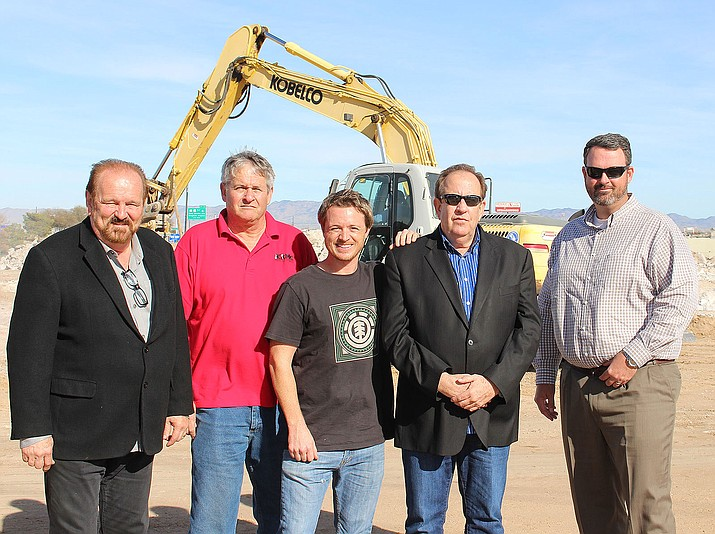 From left, Steve Lambrecht, investor in Ventura Hotels Ltd.; Fred Lingenfelter, owner of the land; Randy Shuffler, land broker; Michael Carnel, partner in Medallion Hospitality; and Dan Del Monaco, branch manager of Mohave State Bank, stand at the site of the future Home 2 Suites hotel by Hilton.