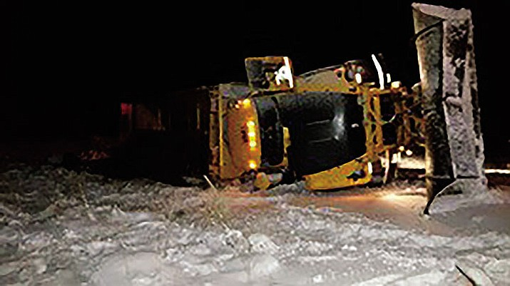 A snowplow lays on its side after a crash last month.
