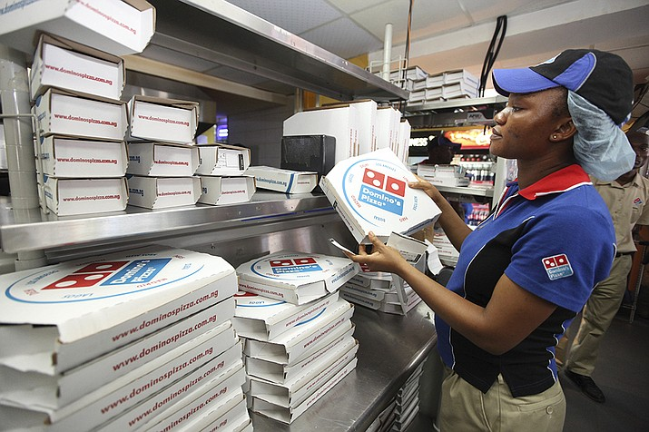 A worker prepares boxes at a Domino's pizza restaurant in Lagos, Nigeria. Domino's announced on Feb. 8, 2017, that it launched a wedding registry site just in time for Valentine's Day.