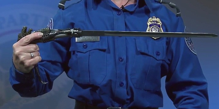 A 80-year-old woman going through airport security in South Carolina had no idea her walking cane contained a hidden sword. In this screenshot from a Transportation Security Administration video a TSA screener warns travelers that the cane they purchased at an antique or thrift store may have a hidden sword inside.