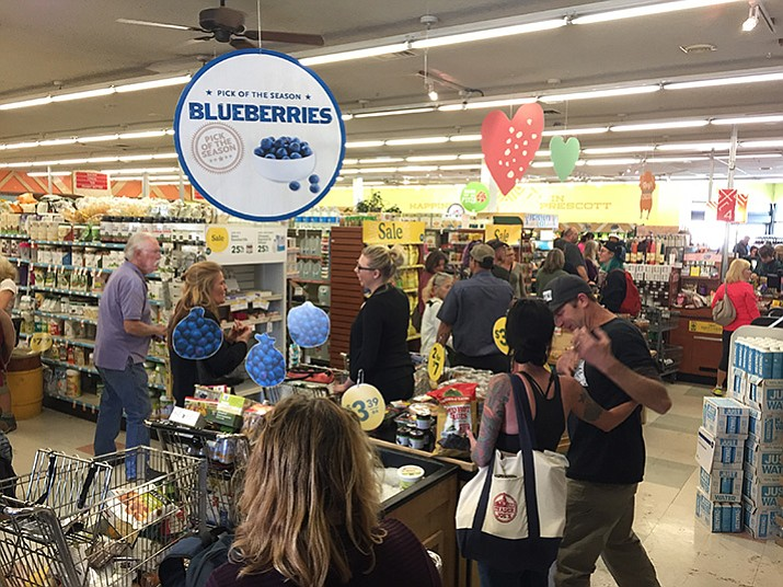 Grocery shoppers line up at the Whole Foods Market in Prescott on Wednesday, Feb. 8, 2017, during the store's liquidation sale.