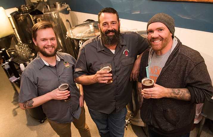 Local brewers Prescott Brewing Company's Brett Helzer, Granite Mountain Brewing's Jerrad Smith and Lonesome Valley Brewing's Brian Cole celebrate the untapping of their Belgium Double for AZ Beer Week on Thursday, Feb. 9. Visit dCourier.com for the Beer Week schedule, which also published in Thursday's Courier.