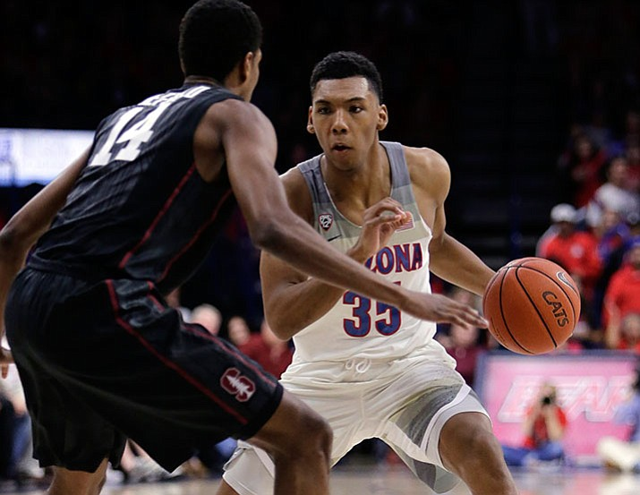 Arizona guard Allonzo Trier (35) drives during the first half of an NCAA college basketball game against Stanford, Wednesday, Feb. 8, in Tucson.