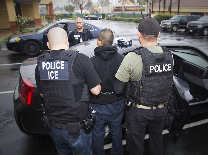 Foreign nationals are arrested during a targeted enforcement operation conducted by U.S. Immigration and Customs Enforcement (ICE) aimed at immigration fugitives, re-entrants and at-large criminal aliens. (Charles Reed/U.S. Immigration and Customs Enforcement via AP)