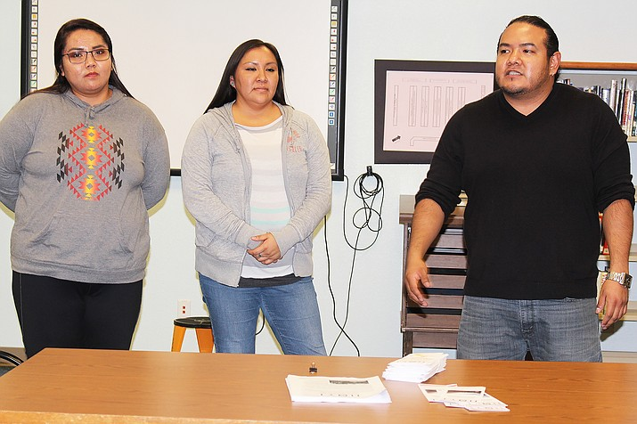 Staff from Hopi Opportunity Youth Initiative (HOYI) talk with the Hopi Jr/Sr High School Parent Advisory Committee. From left: Lexie James, Hannah Honani and Kyle Knox. Photo/Stan Bindell