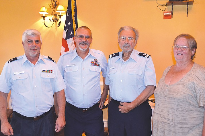 Left to right: Commander Raymond J. Saunders, Flotilla Staff Officer Paul R. De Nubilo, Vice Commander Paul F. De Nubilo and Past Commander Mary Napier.